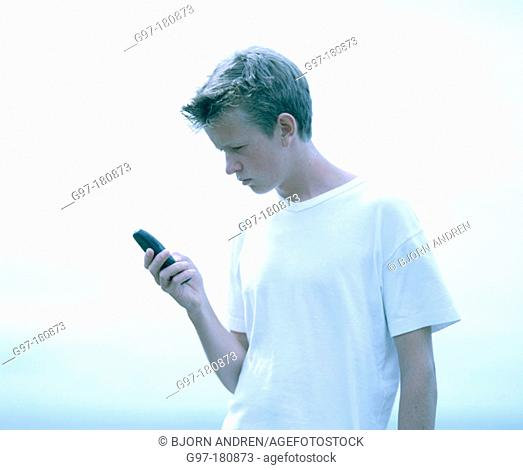 Teen boy using cell phone