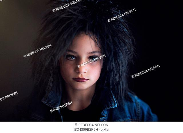 Portrait of girl dressed up as punk looking at camera