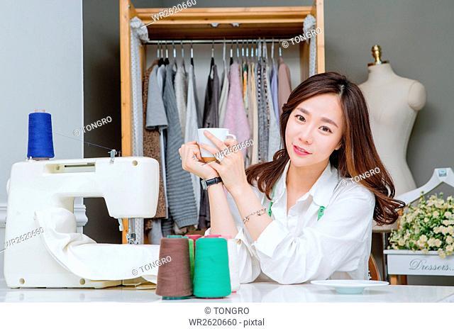 Portrait of female fashion designer