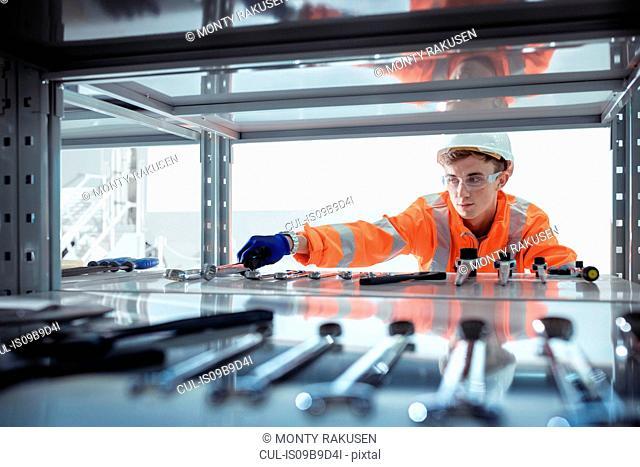 Apprentice selecting tools at railway engineering facility