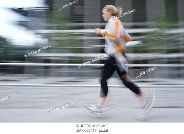 A young athletic woman, 15-20 20-25 25-30 years old, blond, sporty, running, jogging