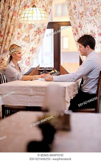young couple having dinner at a restaurant