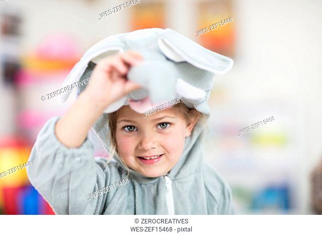 Portrait of happy girl wearing elephant costume in kindergarten