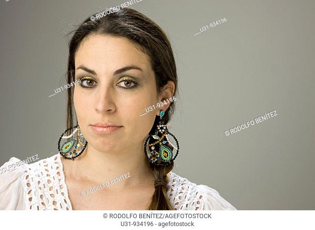 Latin woman with big brown eyes looking at the camera