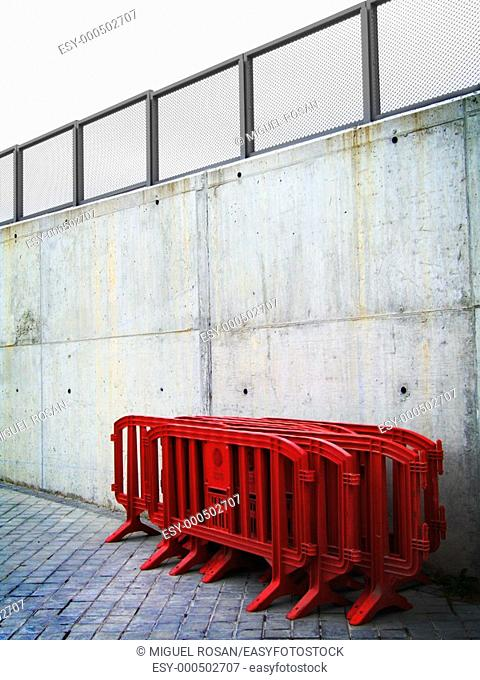 Red plastic fences prepared for eventual limitation