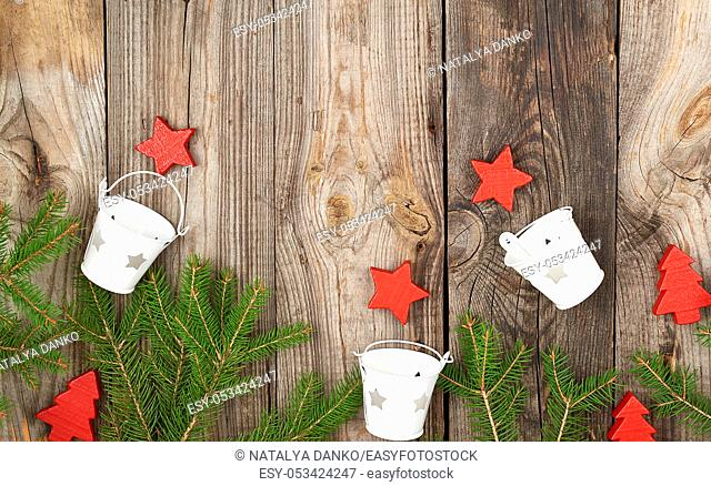 green branches of needles on a gray old background from shabby boards, festive Christmas background, copy space