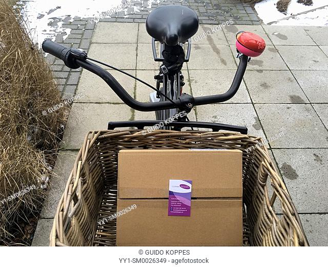 Tilburg, Netherlands. Sturdy, Dutch Transport bicycle, carrying a boxed cargo of new, fresh business cards
