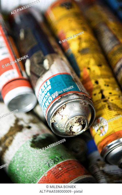 Discarded aerosol cans, close-up