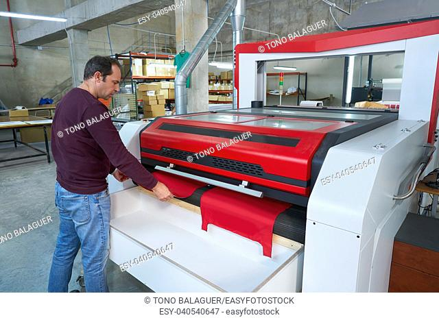 Laser cutting machine production operator for textile transfer fashion industry factory