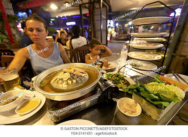 Tourists eating in a typical Cambodian restaurant, Siem Reap Province, Cambodia