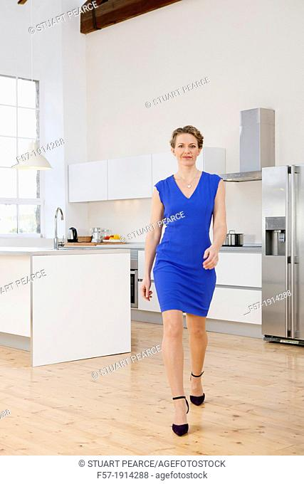 Attractive young businesswoman going to work