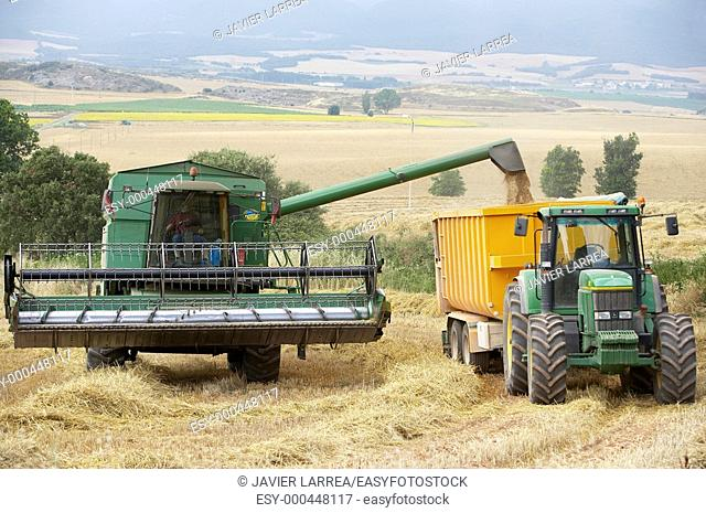 Combine-harvester, wheat fields, Finca Learza, near Estella, Basque Country, Spain