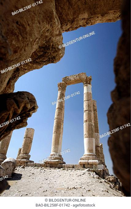 The old ruins with the Temple of Hercules in the stronghold on a hill in the middle of the city of Amman of the capital of Jordan in Arabia