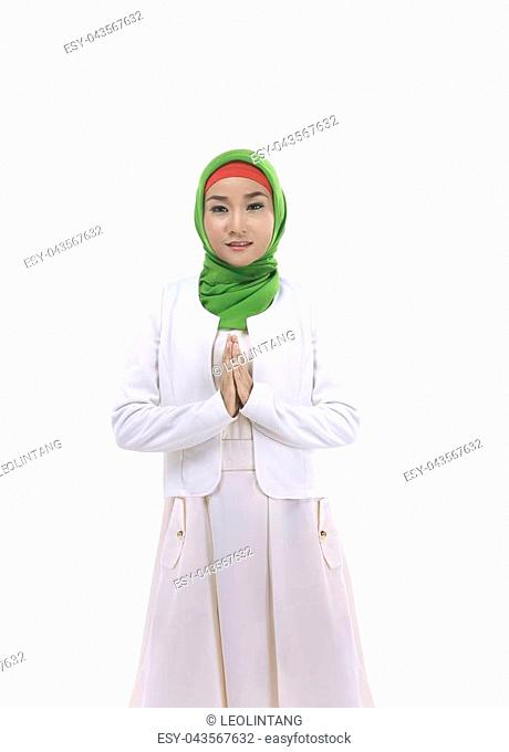 Image of young muslim woman smiling isolated over white background