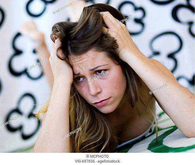 young sad woman tearing at her hair  - 25/01/2008