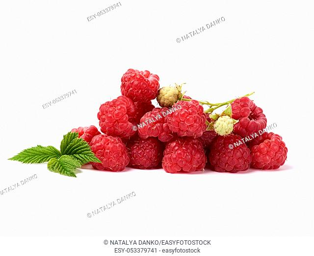 bunch of red ripe raspberries and green leaf on a white background, summer sweet crop