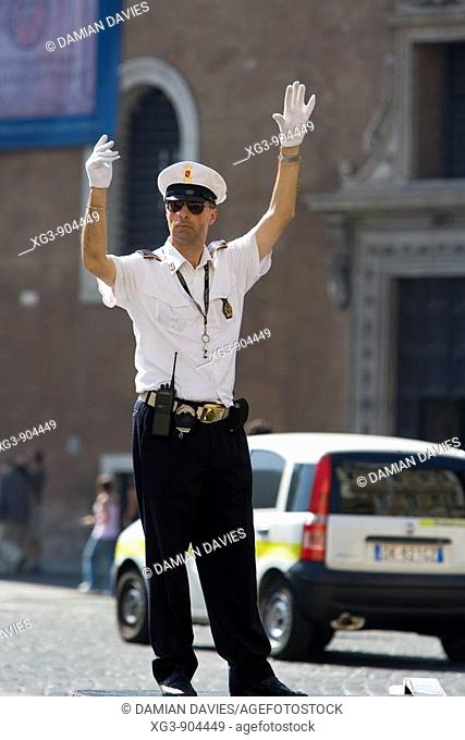 Traffic policeman directing traffic in Rome, Italy