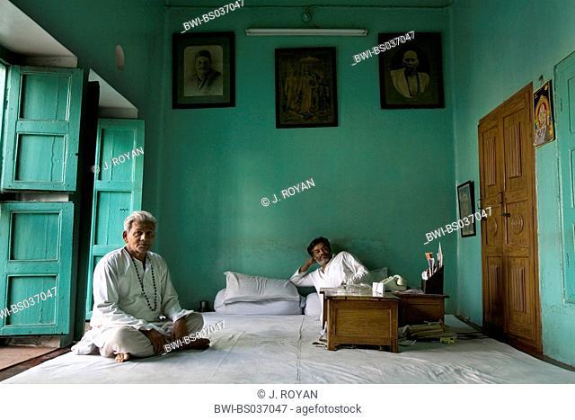 two priests sitting on the floor, India, Varanasi