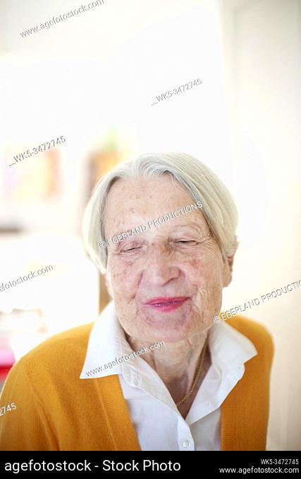 Portrait of happy senior woman feeling beatific, inner bliss