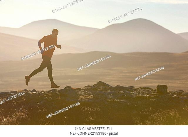 Person jogging at dusk