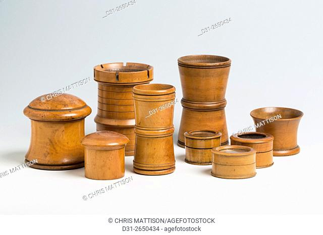 A small collection of nineteenth century treen containers, including dice shakers, pill boxes and specimen pots