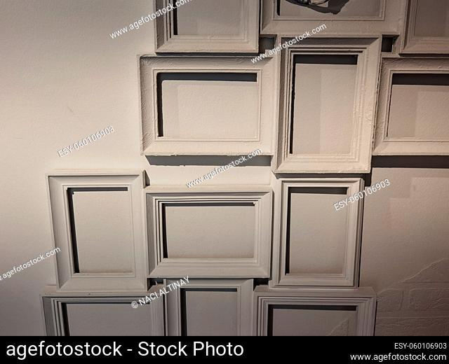 Picture frames in white several next to each other on the wall