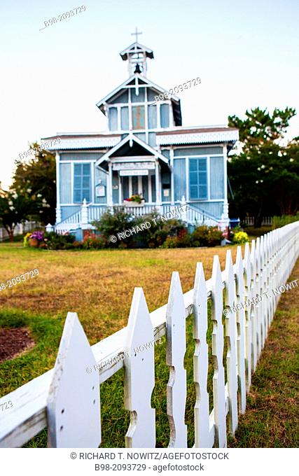 Saint Peter's By the Sea Catholic Church, built in Victorian style and framed by a white picket fence
