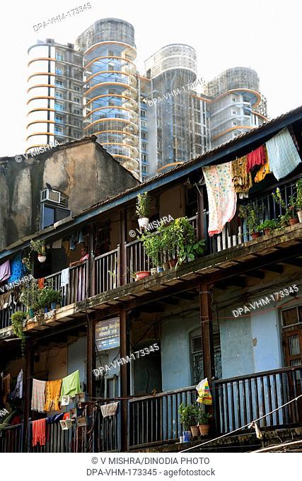 Old chawl daruwala and skyscraper ; Ganpatrao kadam marg ; Lower Parel ; Bombay Mumbai ; Maharashtra ; India 26-August-2009