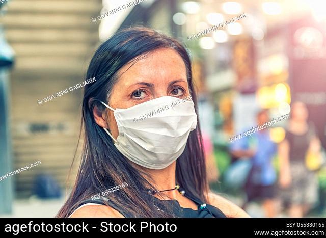 Fear of Coronavirus. Worried woman wearing mask to avoid virus contagion