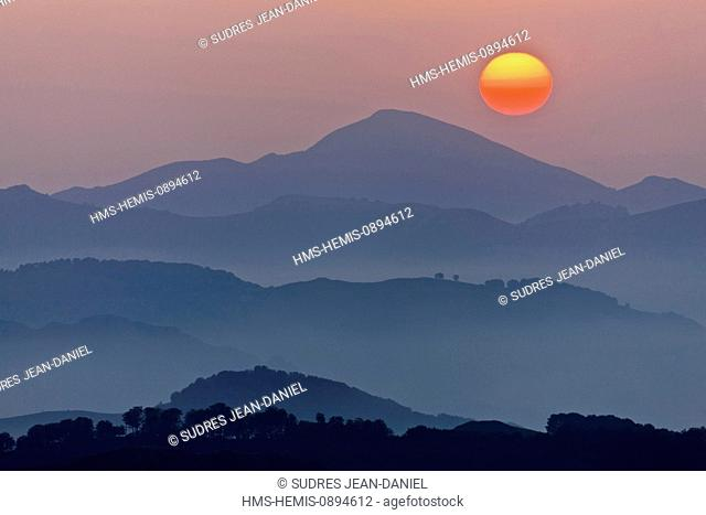 France, Pyrenees Atlantiques, Basque Country, Aussurucq, sunset over the Pyrenees and Basque Arbailles and pastures Ahusquy