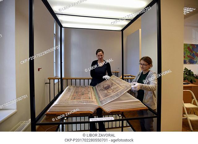 Librarians Ludmila Netusilova, left, and Martina Vodakova adjust facsimile of the Devil's Bible (Codex Gigas) exhibited Municipal Museum of Usti nad Labem