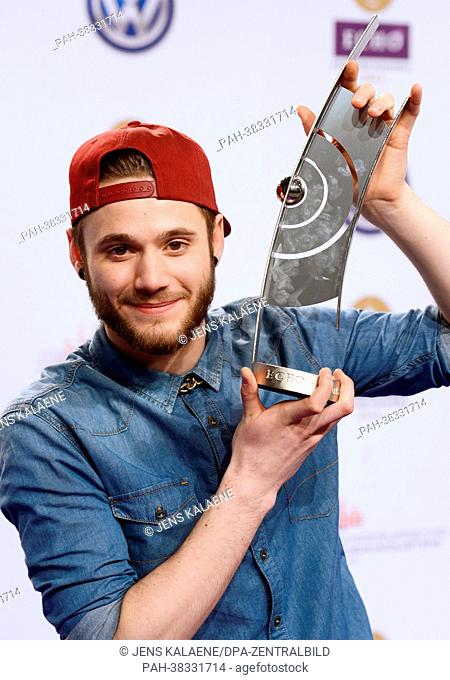 Roman Lob poses with the 2013 Echo Music Award in the category 'hip-hop/urban national/international' in the press room after the Echo Awards ceremony in Berlin