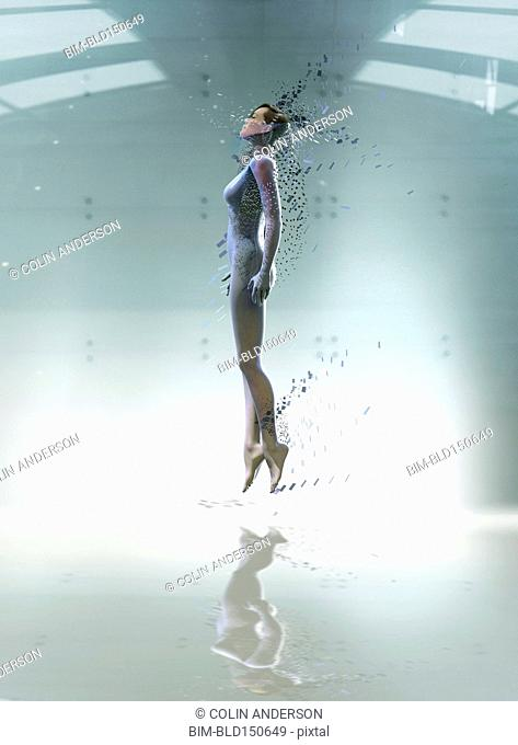 Pacific Islander woman floating in futuristic body scan
