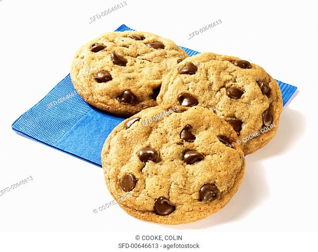 Three Chocolate Chip Cookies on a Blue Napkin