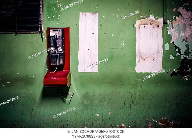 A public pay phone is seen hung on the wall in a patio inside the emergency department of a public hospital in San Salvador, El Salvador, 16 December 2015