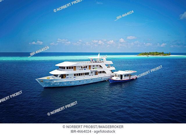 Diving safari ship MS Keana with diving dhoni anchored off an uninhabited palm island, Ari Atoll, Indian Ocean, Maldives