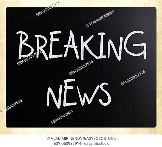 """""""""""""""""""""""Breaking news"""""""" handwritten with white chalk on a blackboard"""