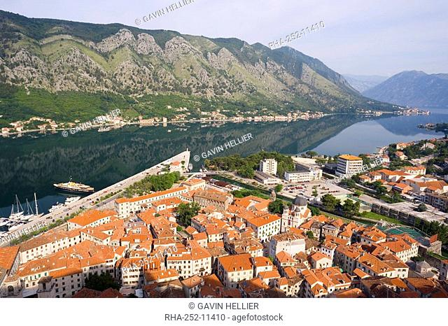 Elevated view over the Old Town, fjord and mountains from the walls of the Kotor Fortress which forms a continuous belt around the Old Town, Kotor