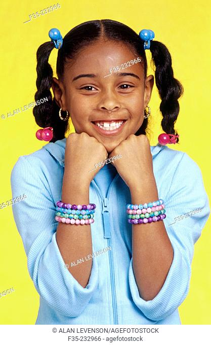 Smiling Girl with Braids and Bracelets