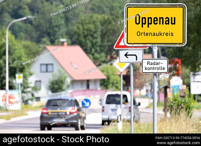 13 July 2020, Baden-Wuerttemberg, Oppenau: Place name sign of Oppenau, surrounded by mountains and forests in a valley. Because of the police operation in...