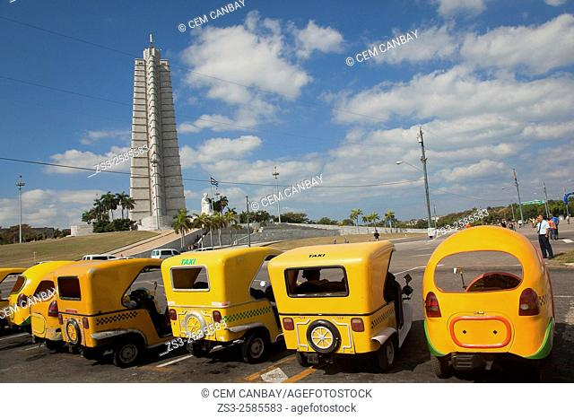 Coco taxis waiting for the tourists in front of the Jose Marti Monument at Plaza de la Revolucion Square, Vedado, Havana, Cuba, Central America
