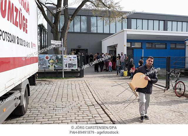 Refugees leave a sports hall previously used as temporary accommodation in Berlin, Germany, 31 March 2017. All such halls have now reverted back to their...
