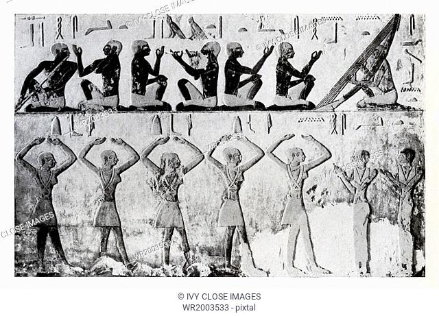 The hieroglyphic inscriptions on this relief from a tomb at Saqqara tell what the figures are doing. Along the top row the signs above the heads say singing