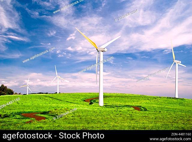 Windmills under blue sky. Hawaii