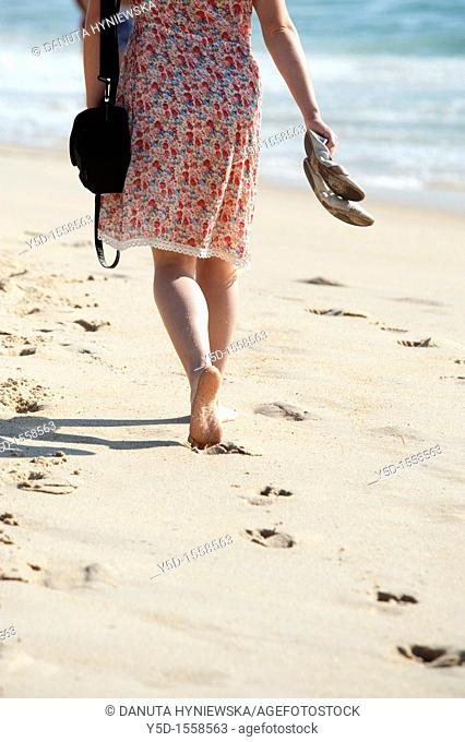 Atlantic Ocean beach, Atlantic Ocean coast, woman walking barefoot on the beach, Portugal
