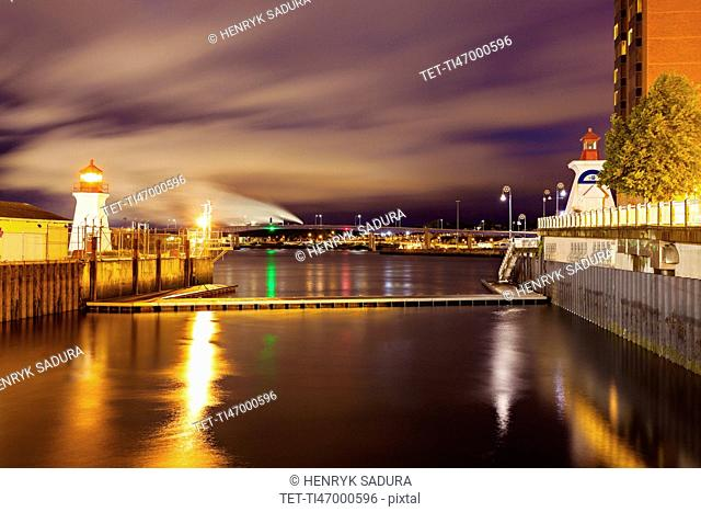 Illuminated Saint John Coast Guard Base Lighthouse seen from harbor