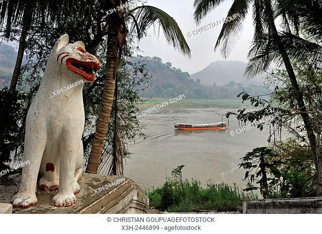 Wat Xiengthong Temple's statue by the Nam Khan River, Luang Prabang, Laos, Southeast Asia