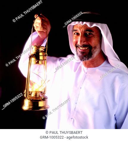 Ramadan: Arab man holding lantern