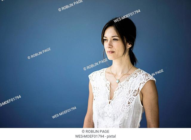 Portrait of a beautiful woman against blue background