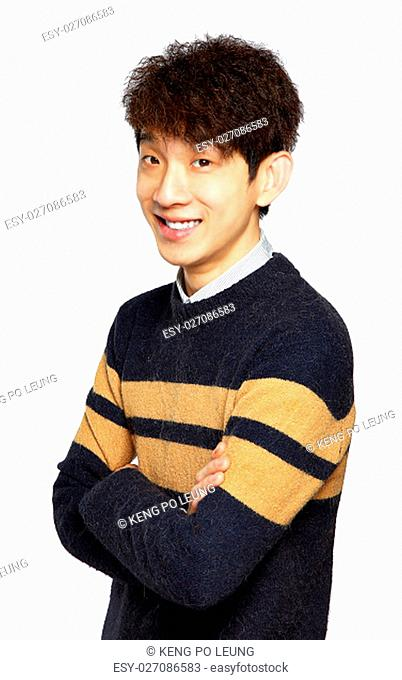 Portrait of happy asian man with arms folded